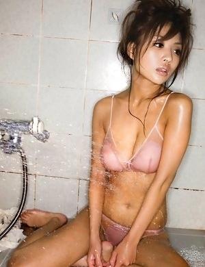 Kana Tsugihara has big cans and sexy tummy in wet shirt