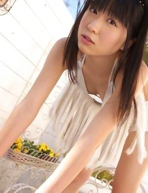 Hijiri Sachi in shorts and bra enjoys sun on her curves