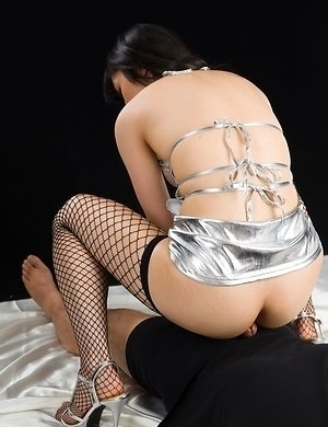 Fishnets-wearing hottie Reo Saionji mock-riding a guy's cock in an assjob gallery