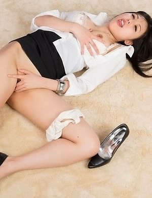 Office beauty Natsuki Yokoyama takes off her heels to jerk this dude's cock
