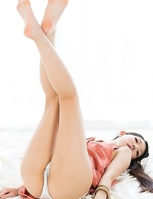 Rio Kamimoto shows her long legs and her welcoming pussy while on all fours